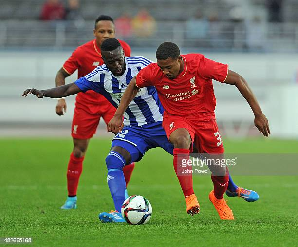 Jordon Ibe of Liverpool FC and Formose Mendy of HJK Helsinki in action during the pre season friendly match at Olympic Stadium on August 1, 2015 in...
