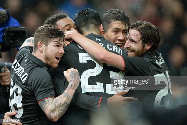 Jordon Ibe of Liverpool is congratulated by teammates after scoring the opening goal during the Capital One Cup semi final first leg match between...