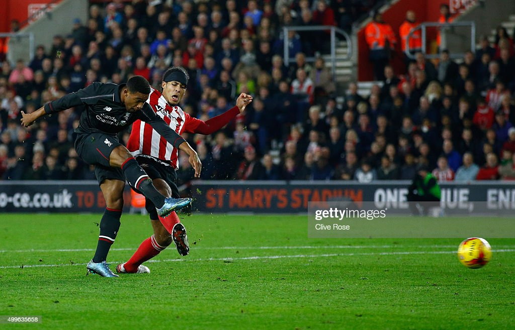 Jordon Ibe of Liverpool shoots past Virgil van Dijk of Southampton as he scores their fifth goal during the Capital One Cup quarter final match between Southampton and Liverpool at St Mary's Stadium on December 2, 2015 in Southampton, England.