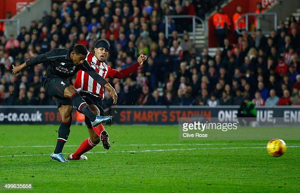 Jordon Ibe of Liverpool shoots past Virgil van Dijk of Southampton as he scores their fifth goal during the Capital One Cup quarter final match...