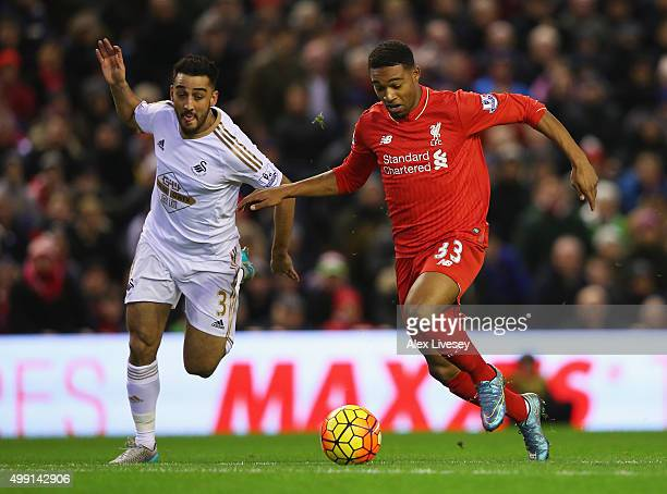 Jordon Ibe of Liverpool takes on Neil Taylor of Swansea City during the Barclays Premier League match between Liverpool and Swansea City at Anfield...