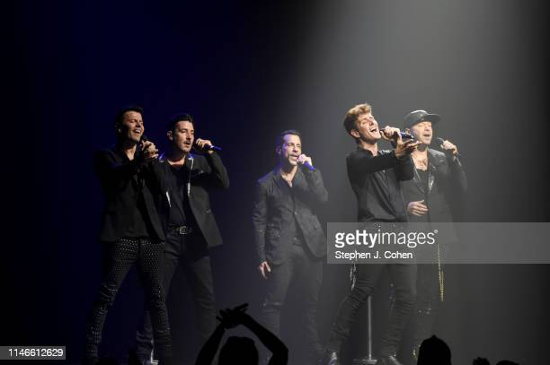 Jordon Knight Jonathan Knight Danny Wood Joey McIntyre and Donnie Wahlberg of New Kids On The Block performs at US Bank Arena on May 02 2019 in...