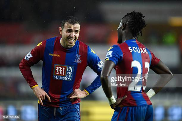 Jordon Mutch and Pape N'Diaye Souare of Crystal Palace in discussion during the Barclays Premier League match between Swansea City and Crystal Palace...