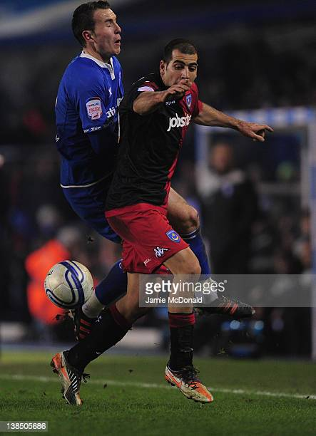 Jordon Mutch of Birmingham City battles with Tal Ben Haim of Portsmouth during the npower Championship match between Birmingham City and Portsmouth...