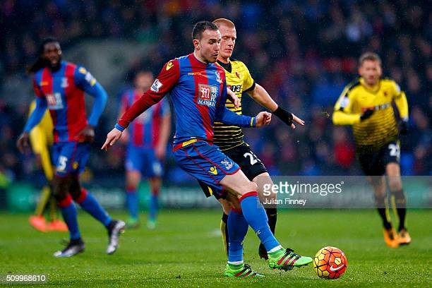 Jordon Mutch of Crystal Palace and Ben Watson of Watford compete for the ball during the Barclays Premier League match between Crystal Palace and...