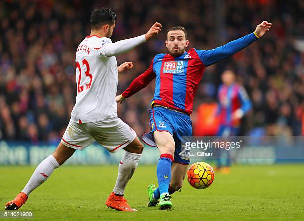 Jordon Mutch of Crystal Palace and Emre Can of Liverpool battle for the ball during the Barclays Premier League match between Crystal Palace and...