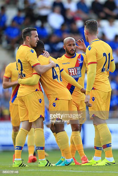 Jordon Mutch of Crystal Palace celebrates his opening goal with team mates during the PreSeason Friendly match between Colchester United and Crystal...