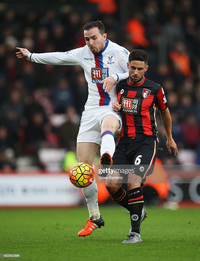 Jordon Mutch of Crystal Palace challenges for the ball with Andrew Surman of Bournemouth during the Barclays Premier League match between A.F.C. Bournemouth and Crystal Palace at Vitality Stadium on December 26, 2015 in Bournemouth, England.