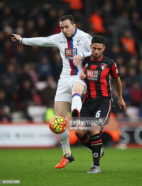 Jordon Mutch of Crystal Palace challenges for the ball with Andrew Surman of Bournemouth during the Barclays Premier League match between AFC...