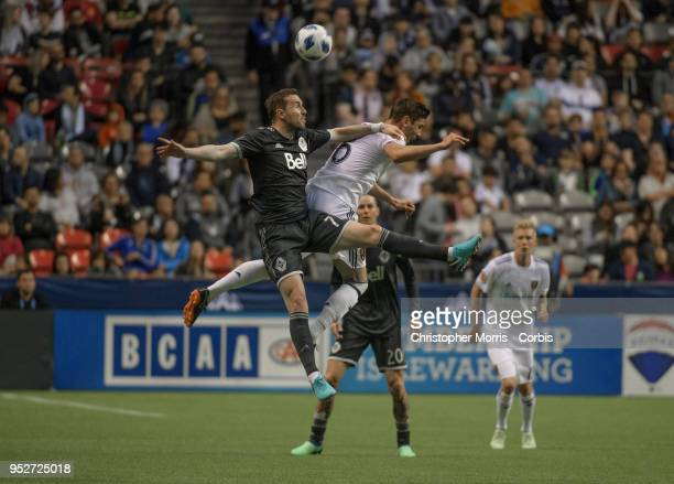 Jordon Mutch of Vancouver Whitecaps heads the ball past Damir Kreilach of Real Salt Lake at BC Place on April 27 2018 in Vancouver Canada