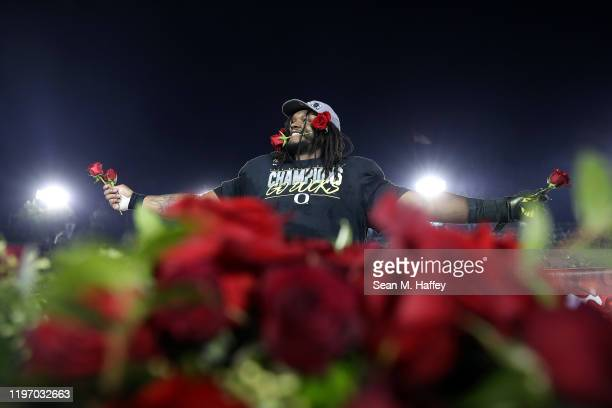 Jordon Scott of the Oregon Ducks celebrates with roses after defeating the Wisconsin Badgers in the Rose Bowl game presented by Northwestern Mutual...