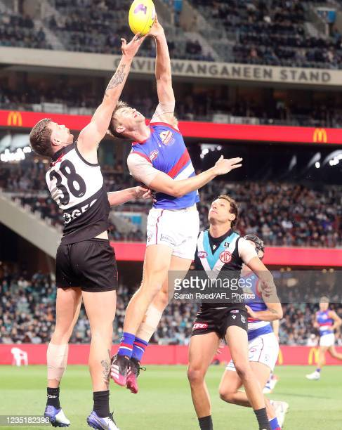 Jordon Sweet of the Bulldogs contests with Peter Ladhams of the Power with Steven Motlop waiting down during the 2021 AFL Second Preliminary Final...