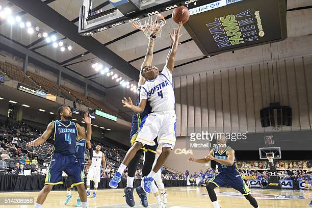 Jordon Talley of the North CarolinaWilmington Seahawks drives to the basket during the Colonial Athletic Conference Championship college basketball...
