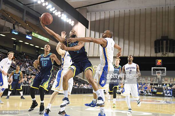 Jordon Talley of the North CarolinaWilmington Seahawks drives to the basket against Juan'ya Green of the Hofstra Pride during the Colonial Athletic...