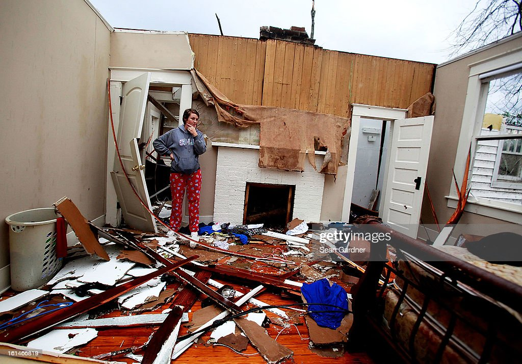 Jordon Williams walks through her bedroom a day after a tornado touched down on February 11, 2013 in Hattiesburg, Mississippi. Hundreds of homes were destroyed and over sixty people injured when the tornado ripped through the town.