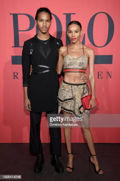 Jordun Love and guest attend the Polo Red Rush Launch Party with Ansel Elgort at Classic Car Club Manhattan on July 25 2018 in New York City