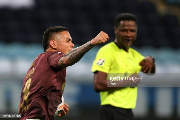 Jordy Alcivar of LDU Quito celebrates after scoring the first goal of his team during a round of sixteen second leg match between Gremio and Liga...