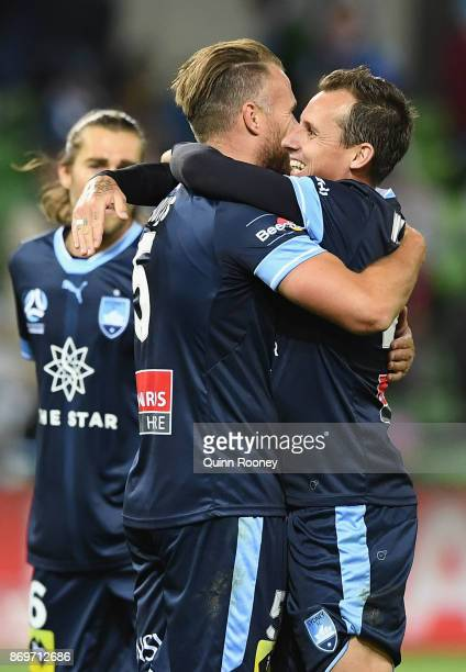 Jordy Buijs and Luke Wilkshire of Sydney FC celebrate winning the round five ALeague match between Melbourne City FC and Sydney FC at AAMI Park on...