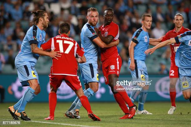 Jordy Buijs of Sydney and Baba Diawara of Adelaide compete for the ball during the FFA Cup Final match between Sydney FC and Adelaide United at...