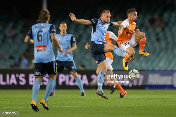 Jordy Buijs of Sydney and Eric Bautheac of Brisbane contest the ball during the round eight ALeague match between Sydney FC and the Brisbane Roar at...