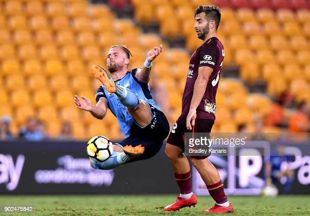 Jordy Buijs of Sydney and Petros Skapetis of the Roar compete for the ball during the round 15 ALeague match between the Brisbane Roar and Sydney FC...
