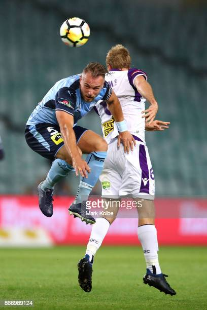 Jordy Buijs of Sydney FC and Mitchell Nichols of the Glory during the round four ALeague match between Sydney FC and the Perth Glory at Allianz...