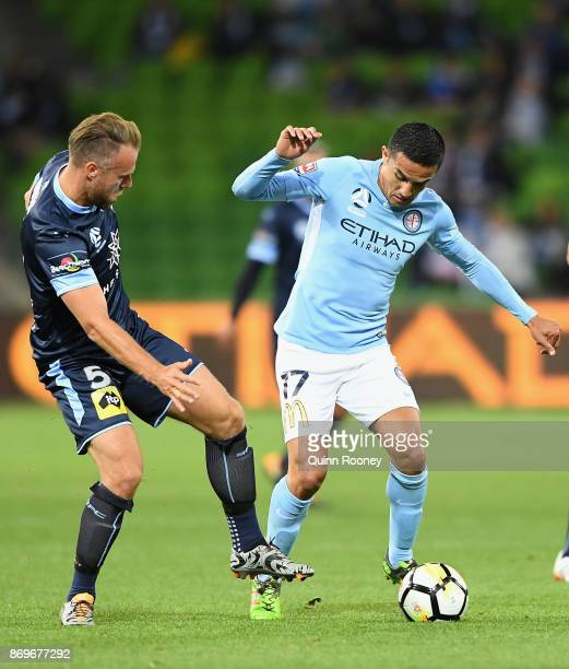 Jordy Buijs of Sydney FC and Tim Cahill of the City compete for the ball during the round five ALeague match between Melbourne City FC and Sydney FC...