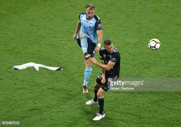 Jordy Buijs of Sydney FC gets the ball away from Jai Ingham of the Victory during the round 18 ALeague match between Melbourne Victory and Sydney FC...