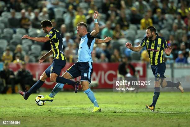 Jordy Buijs of Sydney FC is tackled by the Mariners defence during the round six ALeague match between the Central Coast Mariners and Sydney FC at...