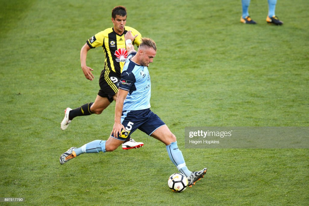 Jordy Buijs of Sydney FC passes under pressure from Andrija Kaludjerovic of the Phoenix during the round 12 A-League match between the Wellington Phoenix and Sydney FC at Westpac Stadium on December 23, 2017 in Wellington, New Zealand.