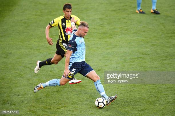 Jordy Buijs of Sydney FC passes under pressure from Andrija Kaludjerovic of the Phoenix during the round 12 ALeague match between the Wellington...