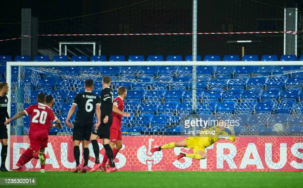 Jordy Clasie of AZ Alkmaar scores the 0-1 goal against Goalkeeper Patrik Carlgren of Randers FC during the UEFA Conference League match between...