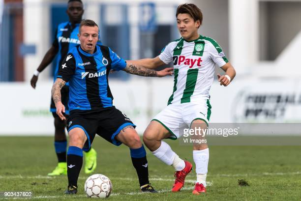 Jordy Clasie of Club Brugge Ritsu Doan of FC Groningen during the friendly match between FC Groningen and Club Brugge at Estadio Municipal on January...