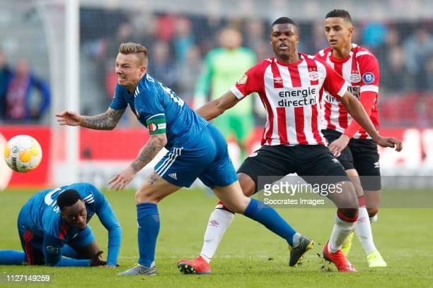 Jordy Clasie of Feyenoord Denzel Dumfries of PSV Mohammed Amine Ihatarren of PSV during the Dutch Eredivisie match between PSV v Feyenoord at the...