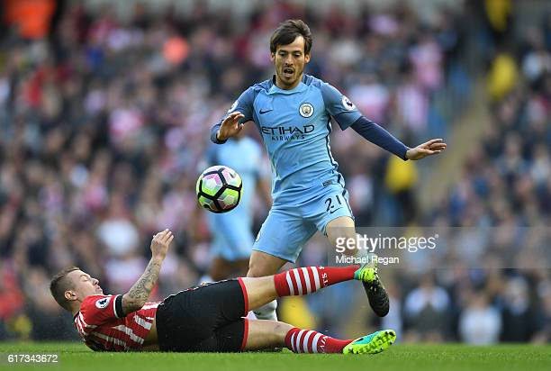 Jordy Clasie of Southampton makes a tackle on David Silva of Manchester City during the Premier League match between Manchester City and Southampton...