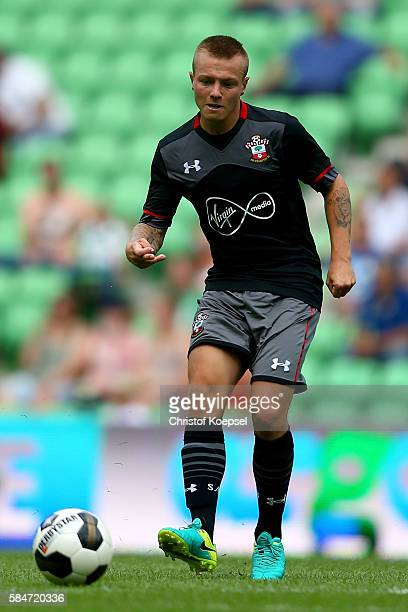 Jordy Clasie of Southampton runs with the ball during the friendly match between FC Groningen an FC Southampton at Euroborg Stadium on July 30 2016...