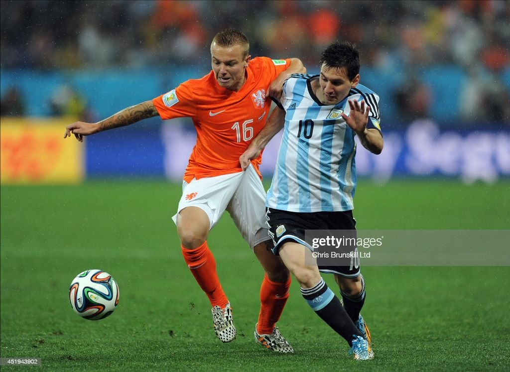 Jordy Clasie of the Netherlands in action with Lionel Messi of Argentina during the 2014 FIFA World Cup Brazil Semi Final match between Netherlands and Argentina at Arena de Sao Paulo on July 09, 2014 in Sao Paulo, Brazil.