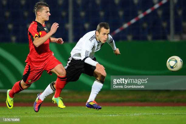Jordy Croux of Belgium chases Steven Bentka of Germany during the U18 International Friendly match between Germany and Belgium at Oberwerth stadium...