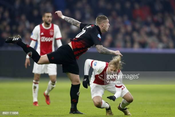 Jordy de Wijs of Excelsior Kasper Dolberg of Ajax during the Dutch Eredivisie match between Ajax Amsterdam and sbv Excelsior at the Amsterdam Arena...