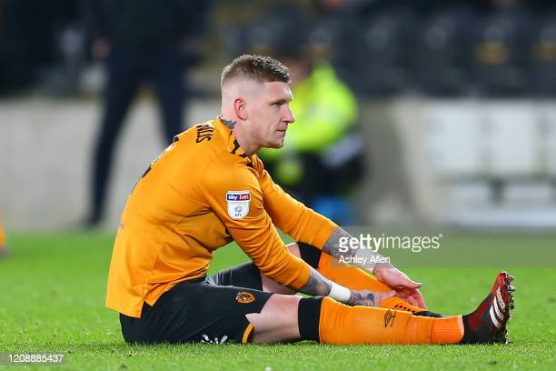 Jordy de Wijs of Hull City picks up an injury during the Sky Bet Championship match between Hull City and Barnsley at KCOM Stadium on February 26...