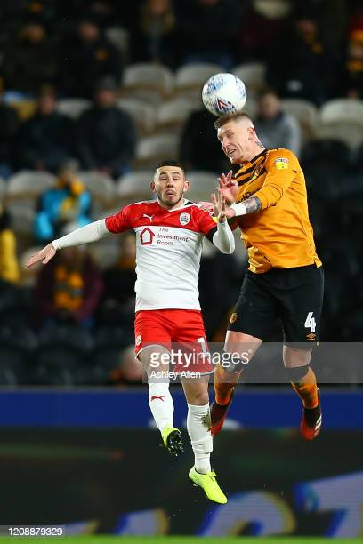 Jordy de Wijs of Hull City wins a header from Conor Chaplin of Barnsley FC during the Sky Bet Championship match between Hull City and Barnsley at...