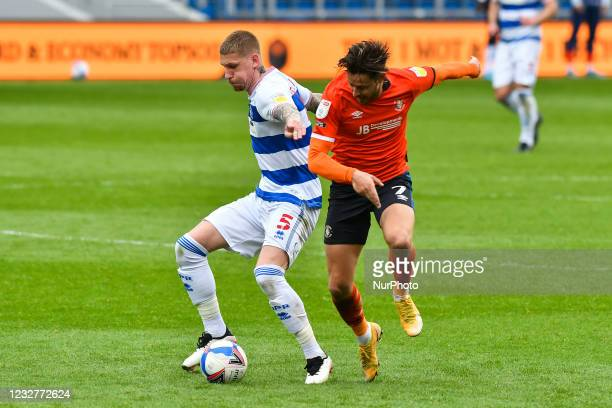 Jordy de Wijs of QPR battles for possession with Harry Cornick of Luton town during the Sky Bet Championship match between Queens Park Rangers and...