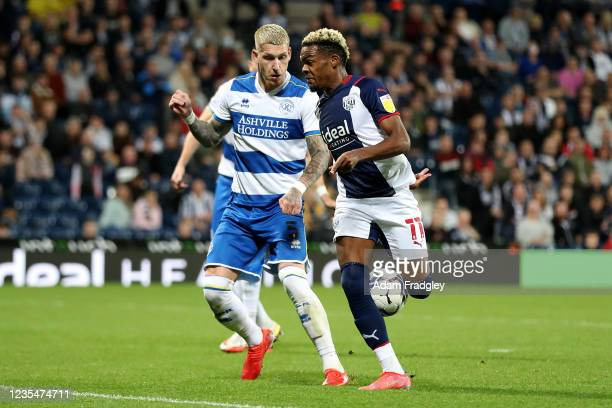Jordy De Wijs of Queens Park Rangers and Grady Diangana of West Bromwich Albion during the Sky Bet Championship match between West Bromwich Albion...