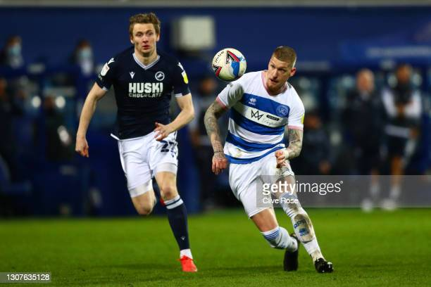 Jordy de Wijs of Queens Park Rangers and Jon Daoi Boovarsson of Millwall FC battle for the ball during the Sky Bet Championship match between Queens...