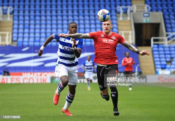 Jordy de Wijs of Queens Park Rangers and Lucas Joao of Reading FC battle for possession during the Sky Bet Championship match between Reading and...