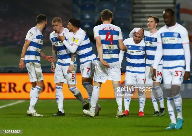 Jordy de Wijs of Queens Park Rangers celebrates with Macauley Bonne and teammates after scoring their team's third goal during the Sky Bet...