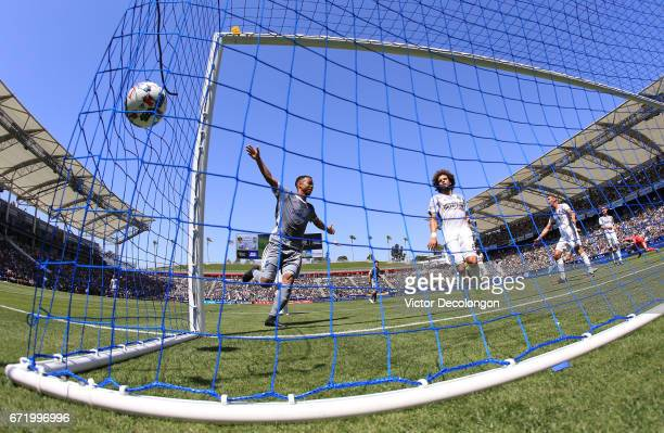 Jordy Delem of Seattle Sounders celebrates a goal by teammate Jordan Morris as Joao Pedro of Los Angeles Galaxy looks on during the first half of...