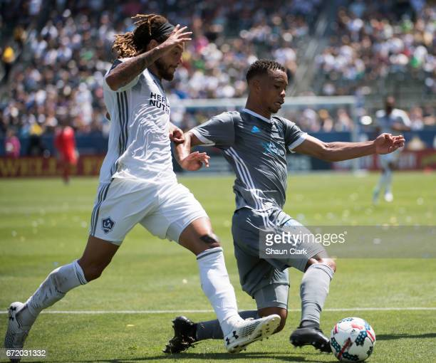 Jordy Delem of Seattle Sounders defends as Jermaine Jones of Los Angeles Galaxy attempt to get the ball during Los Angeles Galaxy's MLS match against...