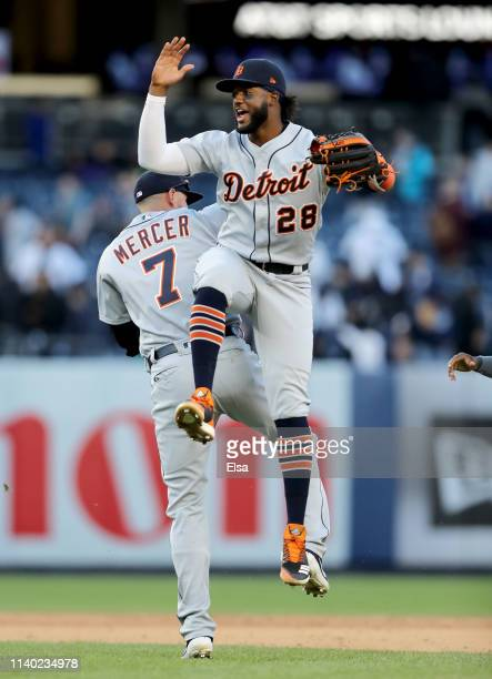 Jordy Mercer and Niko Goodrum of the Detroit Tigers celebrate the 21 win over the New York Yankees at Yankee Stadium on April 03 2019 in the Bronx...
