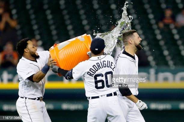 Jordy Mercer of the Detroit Tigers is doused with water by Dawel Lugo and Ronny Rodriguez after hitting a single to drive in Willi Castro and defeat...